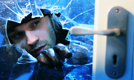 Burglar-breaking-into-house